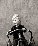 Young boy on tricycle