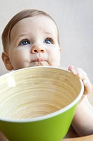 Baby holding large bowl