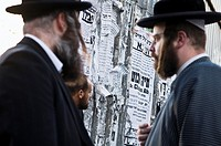 Discussing the latest news. Orthodox men in Mea Shearim neighborhood in Jerusalem.