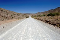 A gravel road leading through the Groot Swartberge mountain range between Calitzdorp and Laingsburg in South Africa's western Cape province
