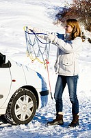 Woman car snow chains