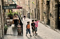 Volterra, Tuscany, Italy  Local boys and trattoria street cafes  Via Porta All' Arco in the centre of the ancient hill town