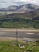 Wales, Gwynedd, Mawddach Estuary, A telecommunications mast high on hills over_looking the Mawddach Estuary with a distant view to Cadair Idris.