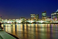 England, London, Southwark, View of Southwark Bridge, the Thames river and the London skyline at dusk. Southwark Bridge was opened in 1921 and was des...