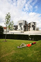 Scotland, City of Edinburgh, Edinburgh, A man having a rest near the Scottish Parliament building in Edinburgh