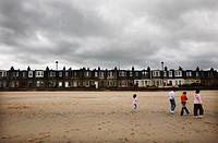 Scotland, City of Edinburgh, Edinburgh, A grey sky over people walking on Portobello beach in Edinburgh