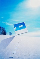 Screen showing blue sky and clouds in winter landscape