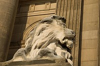 England, West Yorkshire, Leeds, Carved lion on a plinth outside Leeds Town Hall in The Headrow.
