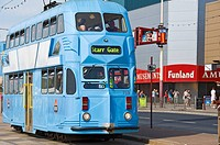 England, Lancashire, Blackpool, An electric tram travelling the Golden Mile in Blackpool.