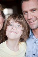 Germany, Cologne, Family portrait, son 6_7 grimacing, close_up