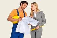 Construction worker and architect holding blueprint, discussing