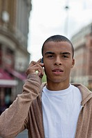 A young man using a mobile phone, portrait