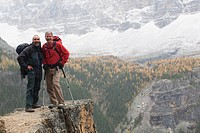 yoho national park, british columbia, canada, two male hikers standing on a cliff in the autumn
