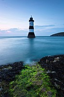 Wales, Anglesey, Penmon, Penmon lighthouse and Puffin Island at Penmon Point on the Isle of Anglesey.
