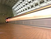 Light trail from subway train into tunnel at The Metro, Washington D C  USA