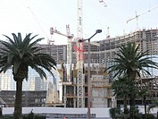 Las Vegas Strip building under construction, palm trees in foreground, USA, Las Vegas, Nevada