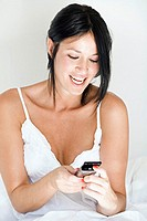Woman with mobile in bed