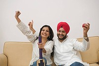 Sikh couple watching television