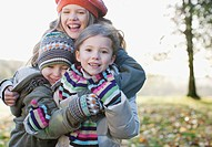Playful children smiling outdoors in autumn