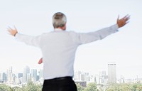 Businessman with arms outstretched on balcony