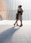 Businesswomen hugging outdoors