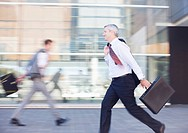 Businessmen rushing outdoors