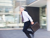 Businessman rushing outdoors