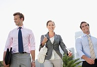 Business people walking together outdoors