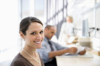 Smiling businesswoman in office (thumbnail)