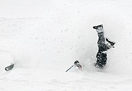 An extreme skier wrecks during the Mountain Sports International, Freesking World Championship preliminary round of competition at Alyeska Resort in G...
