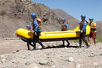People taking raft to rapids