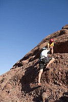 Two men rock climbing