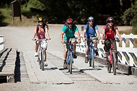 Four people cycling