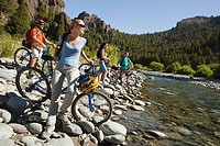 Mountain bikers by a lake