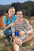 Couple camping in great outdoors