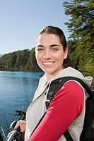 Female mountain biker by lake (thumbnail)