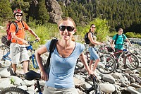 Woman and men with mountain bikes
