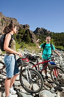 Couple with mountain bikes and camera