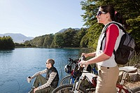 Couple by lake with mountain bikes