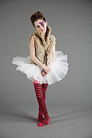 Young girl dressed up in tutu with face paint