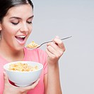 Close_up of a woman eating cereal