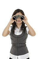 Beautiful Asian businesswoman holding a pair of binocular on a white background