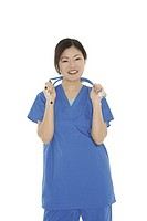 Beautiful Asian doctor or nurse on a white background