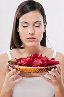 Woman smelling rose petals