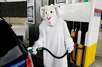 Man in easter bunny costume at gas station
