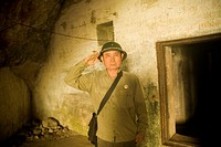 Guide and former soldier serving at bomb-proof secret hospital in Quan Y Cave on Cat Ba Island  Halong Bay, Quang Ninh, Vietnam