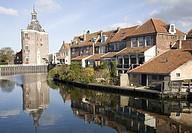 Attractive historic waterside buildings and Drommedaris defence tower, Enkhuizen, Netherlands