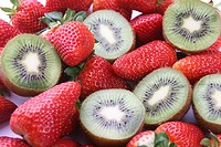 Close up of strawberries and sliced kiwi fruits