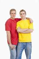 twin brothers standing looking at camera - isolated on white