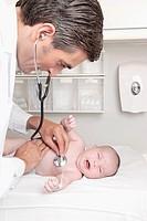 Doctor examining a newborn baby